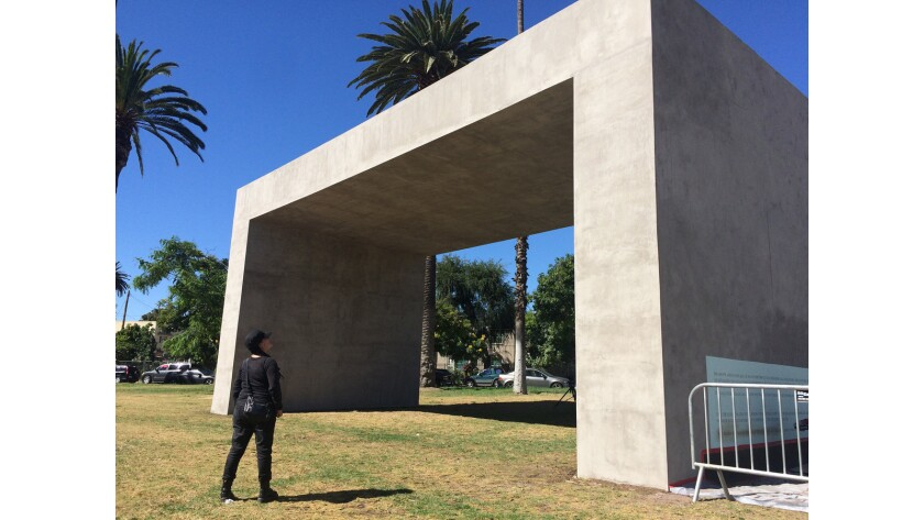 Teresa Margolles stands before the concrete monument she has erected in Echo Park.