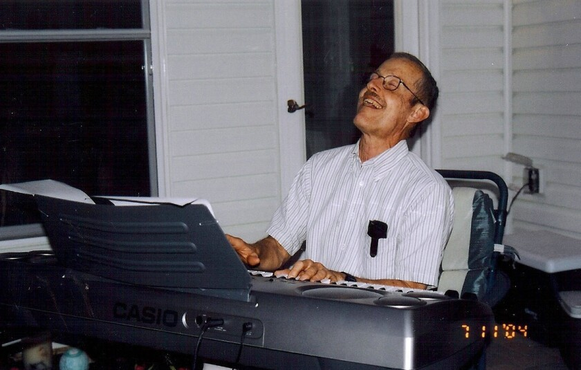 """Bruce Ivins plays the keyboard at a party in 2004. A woman on whom he was fixated -- a Kappa Kappa Gamma sister -- said she found him """"cloyingly nice."""""""