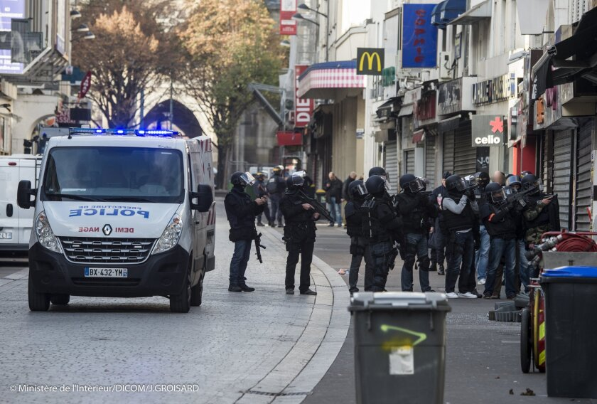 Police security forces raid building for suspect in Paris attacks