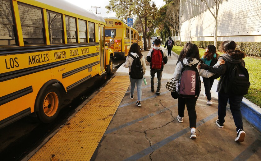 Students ending their first day of classes depart Belmont High School in Los Angeles in 2019.