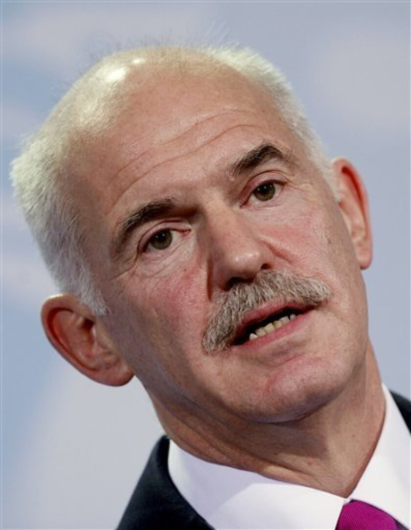 Greek Prime Minister George Papandreou addresses the media after a meeting with German Chancellor Angela Merkel at the chancellery in Berlin, Friday, March 5, 2010. Papandreou met with Merkel on Friday to discuss the current financial crisis in Greece. (AP Photo/Markus Schreiber)