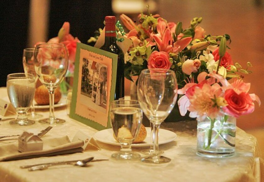Wholesale floral arrangements and Internet truffles kept the newlyweds within their $35,000 budget. (Peggy Peattie / Union-Tribune)