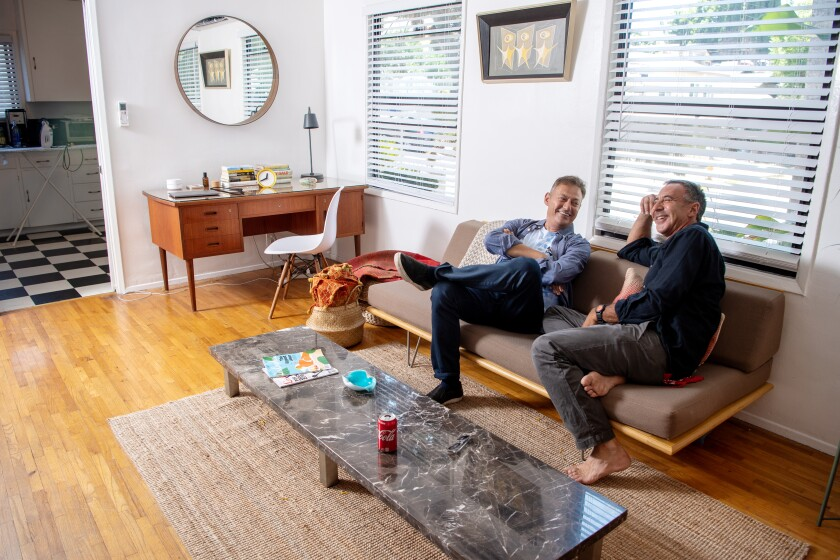 Back home in Silver Lake, Los Angeles magazine editor Maer Roshan, left, relaxes with a friend, Wayne Nathan, on a Sunday afternoon.
