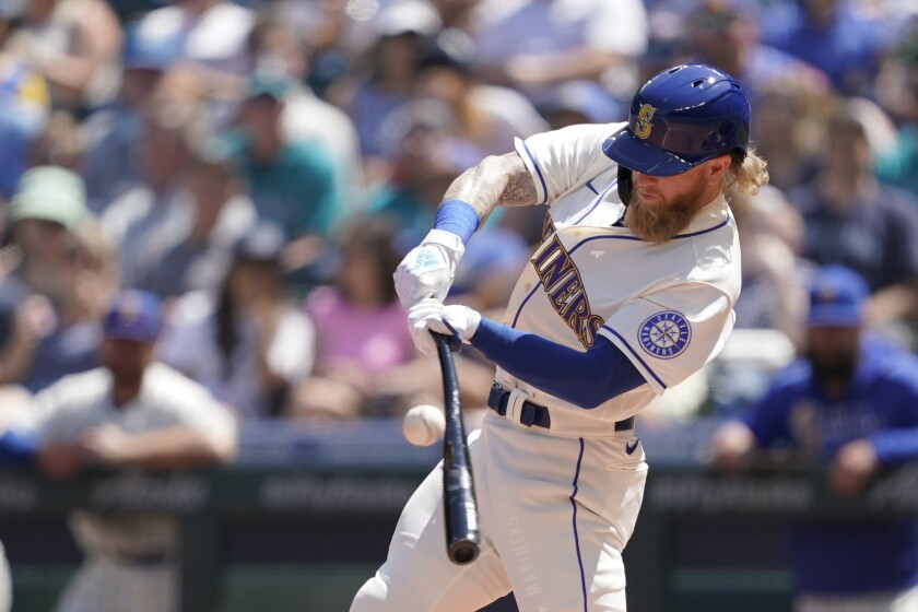 Seattle Mariners' Jake Fraley hits a single against the Los Angeles Angels during the fourth inning of a baseball game, Sunday, July 11, 2021, in Seattle. (AP Photo/Ted S. Warren)