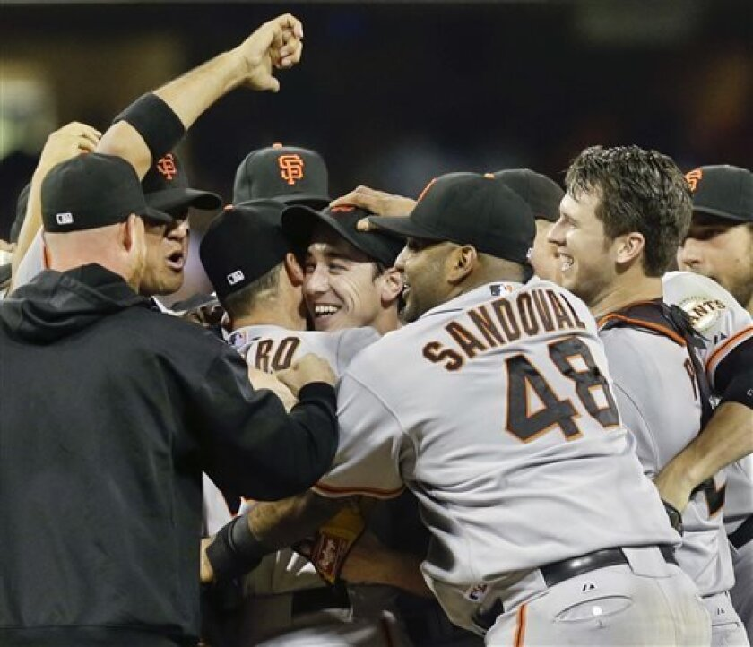 San Francisco Giants celebrate after the no hitter thrown by Tim Lincecum, center, against the San Diego Padres in a baseball game in San Diego, Saturday, July 13, 2013. The Giants won the game 9-0. Tim Lincecum has thrown his first career no-hitter and the second in the majors in 11 days, a gem saved by a spectacular diving catch by right fielder Hunter Pence in the San Francisco Giants' 9-0 win against the last-place San Diego Padres on Saturday night. (AP Photo/Lenny Ignelzi)