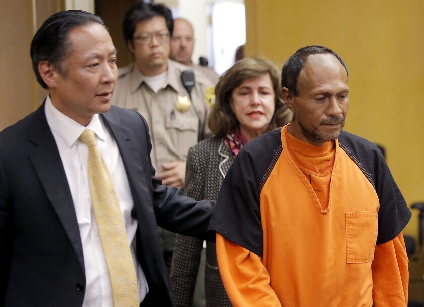 Juan Francisco Lopez-Sanchez, right, is led into a courtroom by San Francisco Public Defender Jeff Adachi on July 7. A judge on Friday ruled that Lopez-Sanchez will stand trial in the death of San Francisco resident Kathryn Steinle.