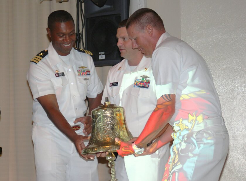 USS La Jolla Commanding Officer Kevin Roach and naval chiefs prepare to present the submarine's 80-pound bell to David MacVean, board chair of the Maritime Museum of San Diego.