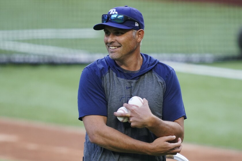 Tampa Bay Rays manager Kevin Cash throws batting practice before Game 1 of the baseball World Series Series.