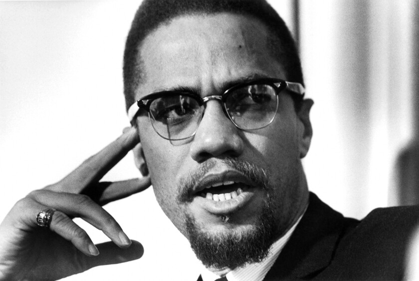 Malcolm X poses for a photo in Rochester, N.Y., on Feb. 16, 1965.