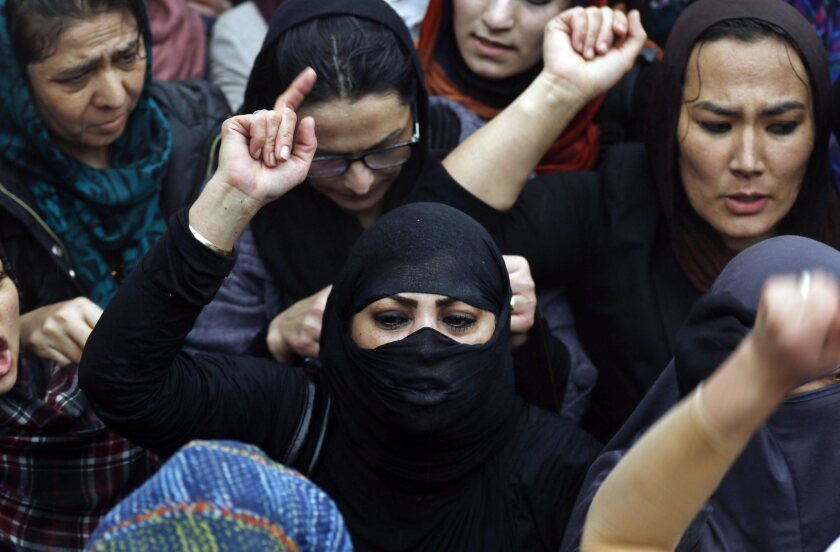 Afghan women shout slogans during a protest in front of the Supreme Court in Kabul, Afghanistan, on March 24 against the killing of Afghan woman Farkhanda.