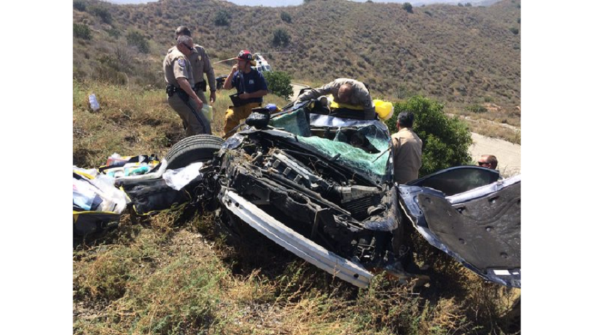 A woman whose car went over an embankment off State Route 241 in Irvine is extricated after being stuck for 14 hours, officials said.