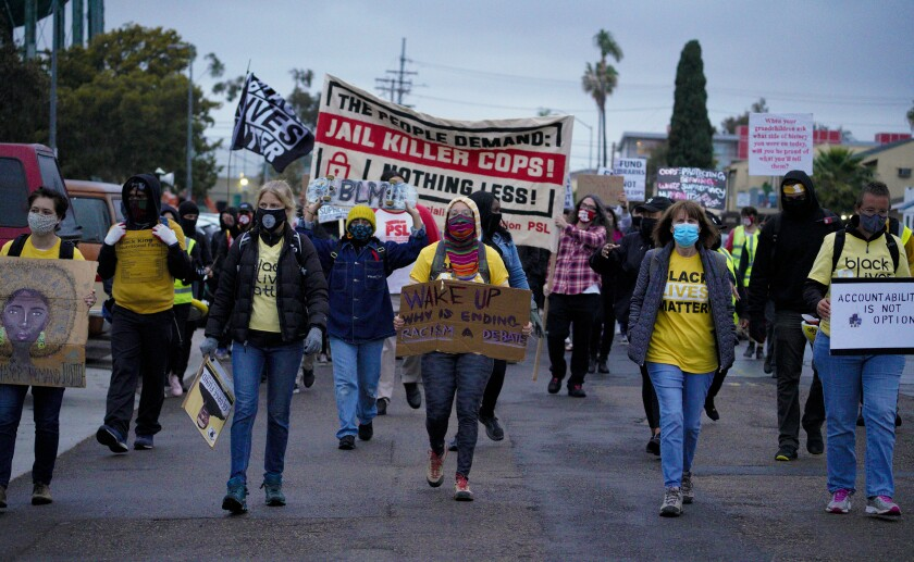 Demonstrators marched down Idaho Street in North Park