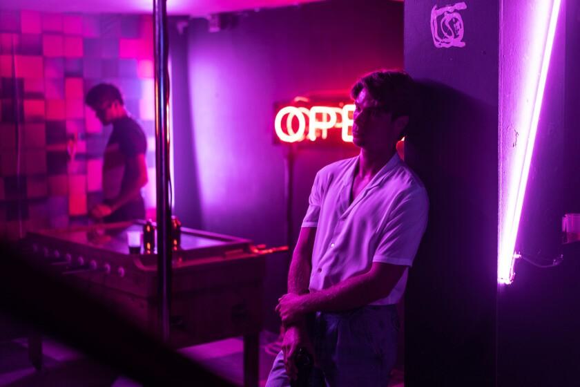 """Kai Luke Brummer relaxes in a bar in the movie """"Moffie."""""""