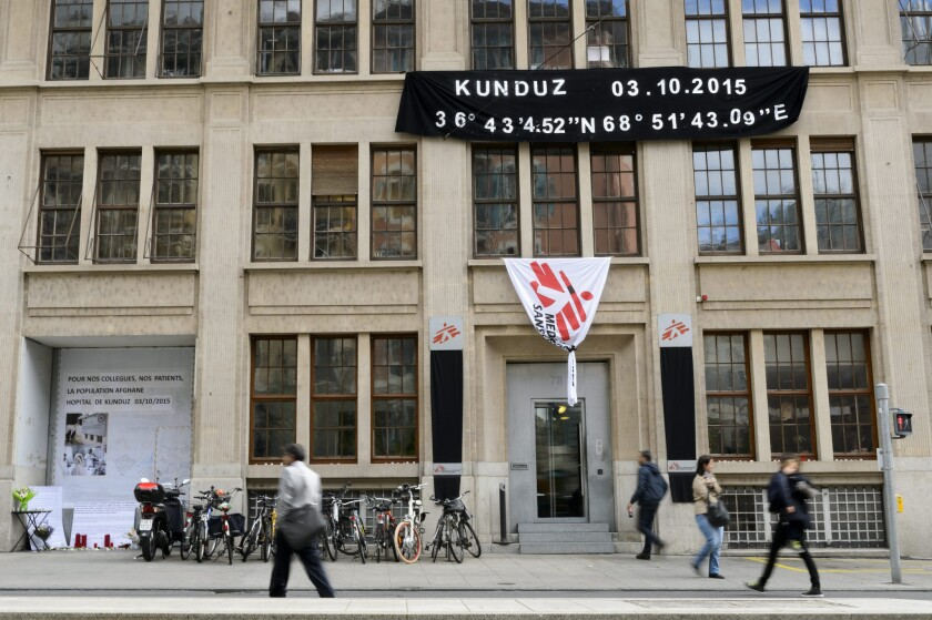 A Doctors Without Borders flag at the group's headquarters in Geneva is partially furled Wednesday as a memorial gesture for the hospital bombing in Afghanistan.