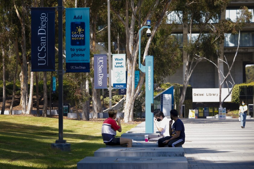 Banners hang from the light poles, asking staff and students to add the CA COVID NOTIFY app.