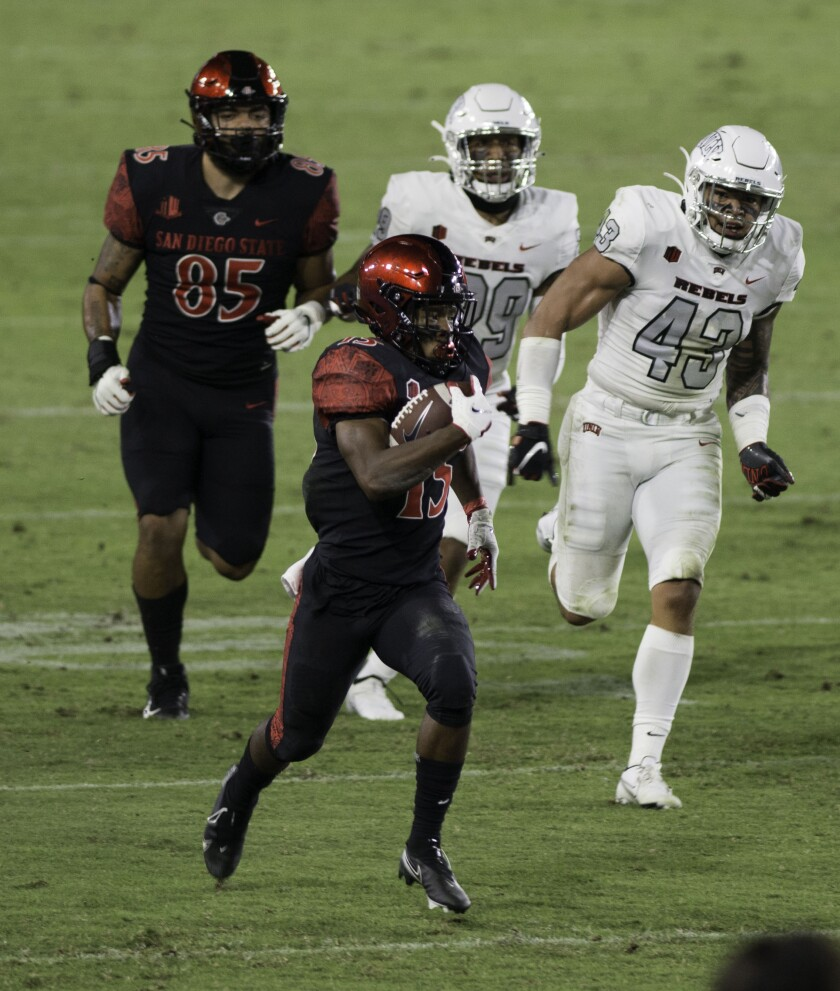 San Diego State's Jordan Byrd runs the ball for a 31-yard gain during Saturday's Mountain West game against UNLV in Carson.