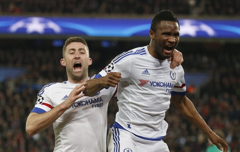Chelsea's John Obi Mikel, right, celebrates with teammate Chelsea's Gary Cahill after scoring his side first goal during the Champions League round of 16, first leg, soccer match between Paris Saint Germain and Chelsea at the Parc des Princes  stadium, in Paris, Tuesday, Feb. 16, 2016. (AP Photo/Fr