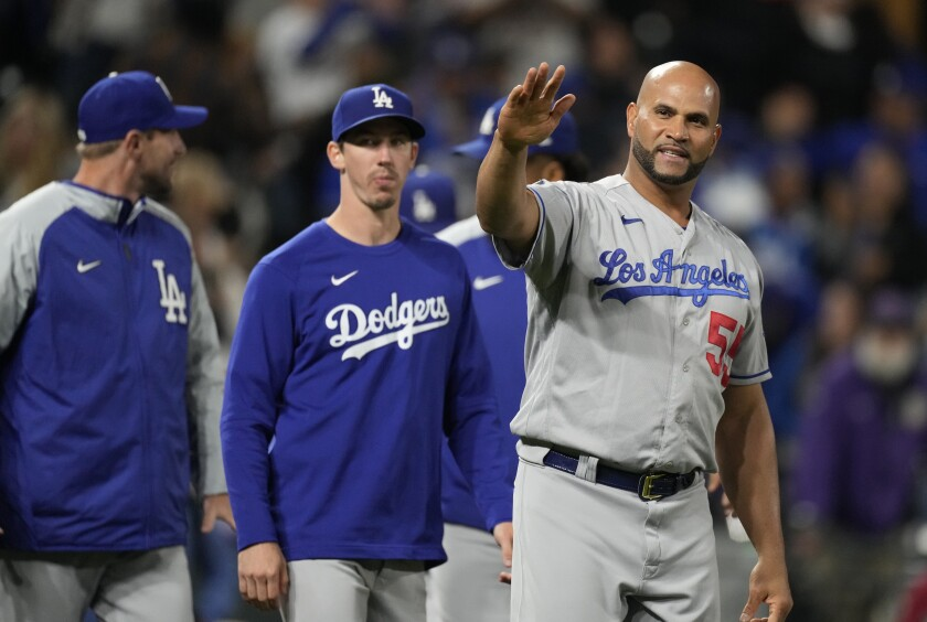 The Dodgers' Albert Pujols waves to fans after the 10th inning against the Colorado Rockies.