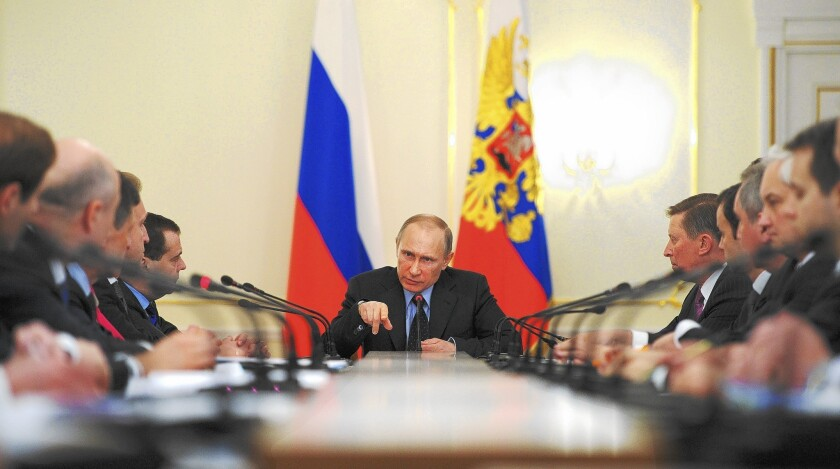 Russian President Vladimir Putin leads a Cabinet meeting at the presidential residence outside Moscow this week. U.S. officials no longer discount the possibility that he might send troops into eastern Ukraine, which could spark a war, or use force against other neighboring countries.