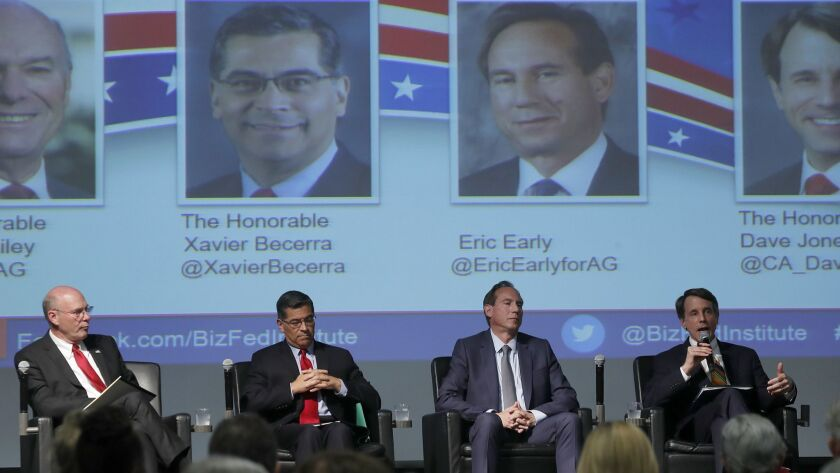 Judge Steven Bailey, from left, California Atty. Gen. Xavier Becerra, attorney Eric Early and California Insurance Commissioner Dave Jones take the stage in Downey for the first of two attorney general candidates' forums Tuesday.