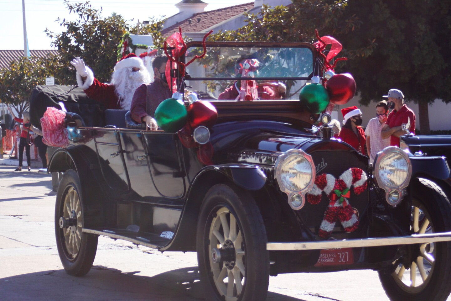 Santa Claus makes his entrance in the Old Black Goose as part of the La Jolla Christmas Parade festivities Dec. 6.