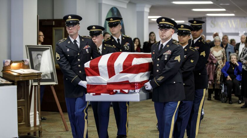 Indiana National Guard Honor Unit troops carry the coffin of Master Sgt. Charles H. McDaniel Sr., who was killed in action during the Korean War and whose remains were returned by the North Korean government.