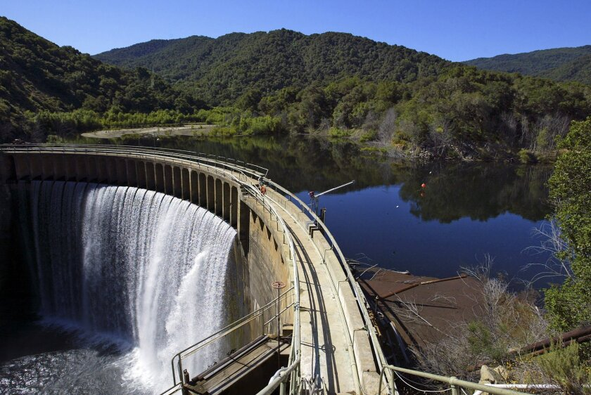 File - In this June 1, 2006 file photo is the San Clemente Dam on the Carmel River in Carmel Valley, Calif.  The largest dam removal project in California history has hit an important milestone with the diversion of a half-mile section of the Carmel River into a man-man river bed. San Clemente Dam