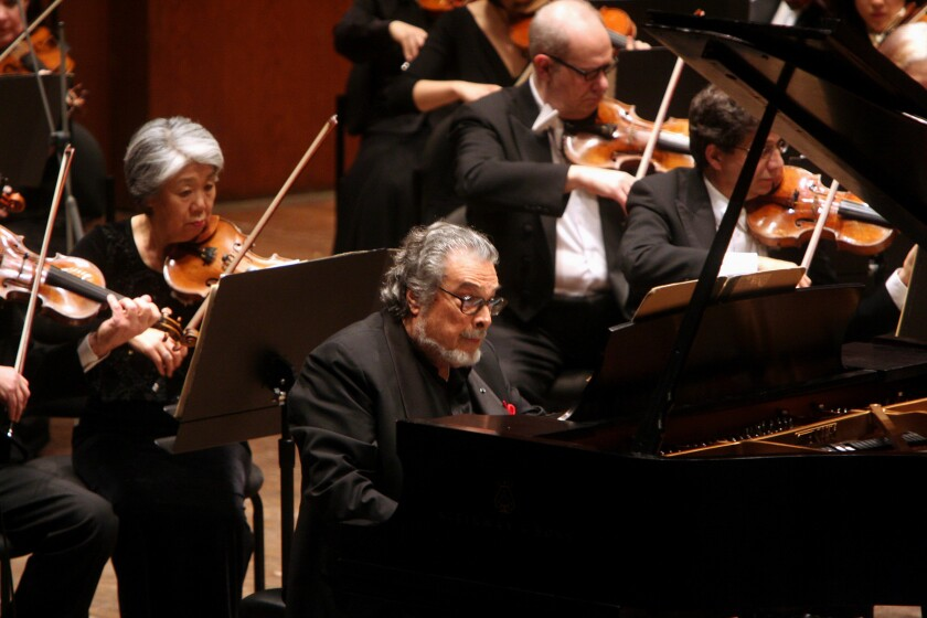 Leon Fleisher performs with members of the New York Philharmonic.