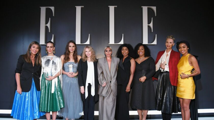 Elle editor-in-chief Nina Garcia from left, Sarah Paulson, Keira Knightley, Mia Farrow, Lady Gaga, Angela Bassett, Shonda Rhimes, Charlize Theron and Yara Shahidi attend Elle's 25th annual Women in Hollywood celebration.