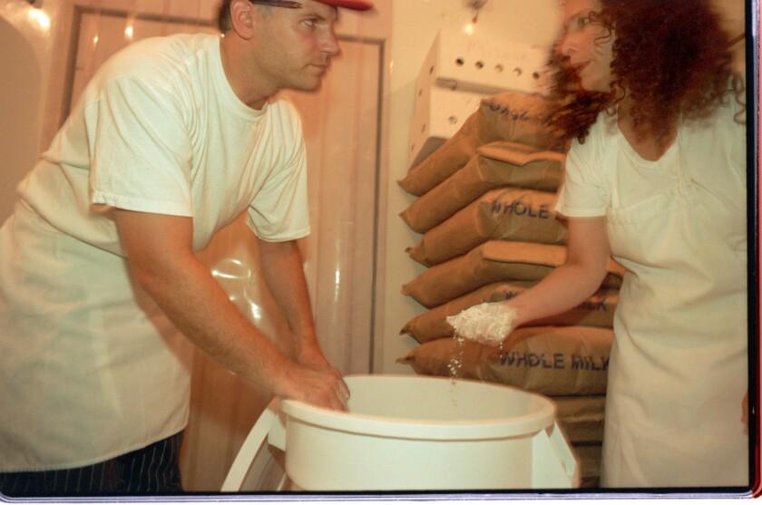 Nancy Silverton and baker George Erasmus are shown in the original La Brea Bakery in 1996.