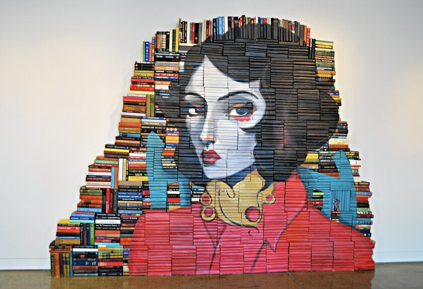 Los Angeles-based artist Mike Stilkey has painted an image of a woman on a stack of books. The piece is on display through April 10 at his exhibit at the Great Park Gallery at the Palm Court Arts Complex in Irvine.