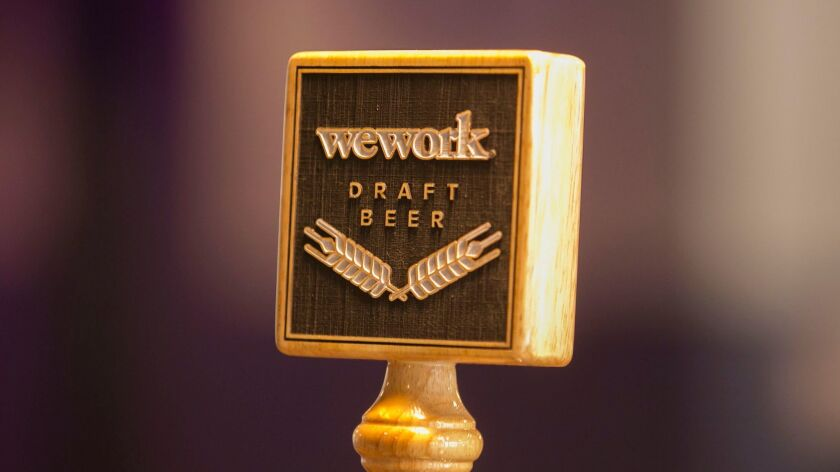 On tap beer is one of the amenities for WeWork members.
