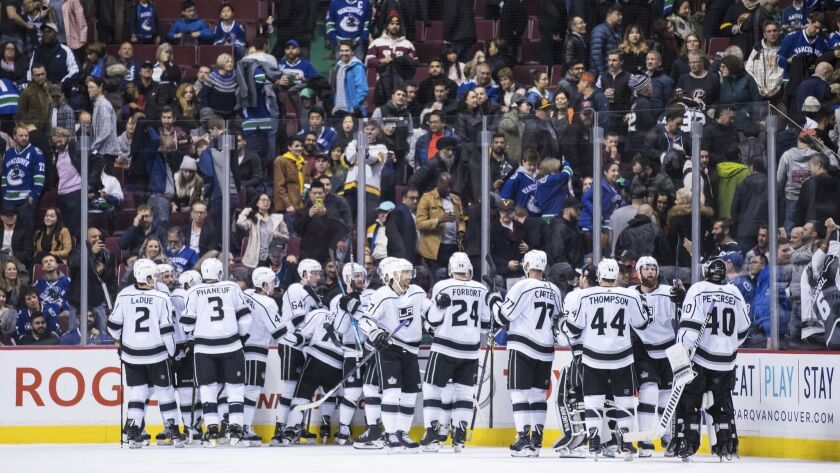 Los Angeles Kings celebrate after defeating the Vancouver Canucks 2-1 during overtime in an NHL hock