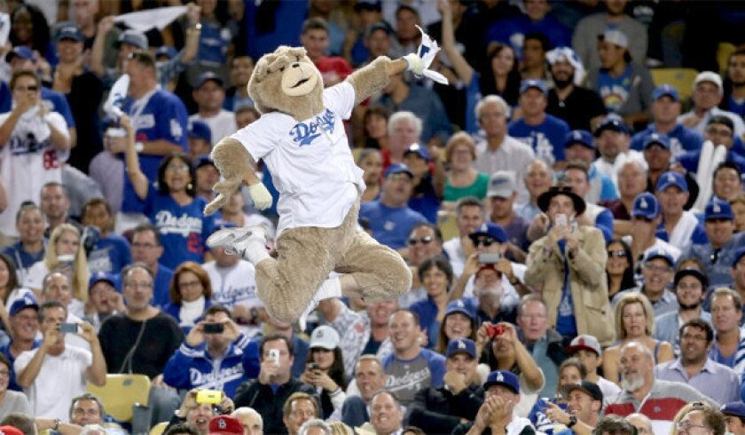 A man dressed in a bear costume jumped on the visiting dugout at Dodger Stadium during Game 3 of the National League Championship Series, earning him a six-month ban from the ballpark.