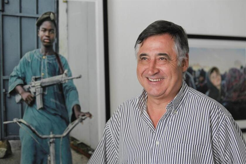 "Famed Spanish photographer Gervasio Sanchez, seen preparing his ""Vida"" exhibition in Tegucigalpa on March 18, 2019, for its opening the next day, has covered dozens of armed conflicts on several continents, but says his career was shaped decisively by his experience in the strife-torn Central America of the 1980s. EFE-EPA/Gustavo Amador"