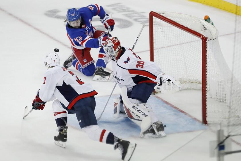 Rangers center Mika Zibanejad puts a shot on Capitals goaltender Ilya Samsonov during the third period of a game March 5.
