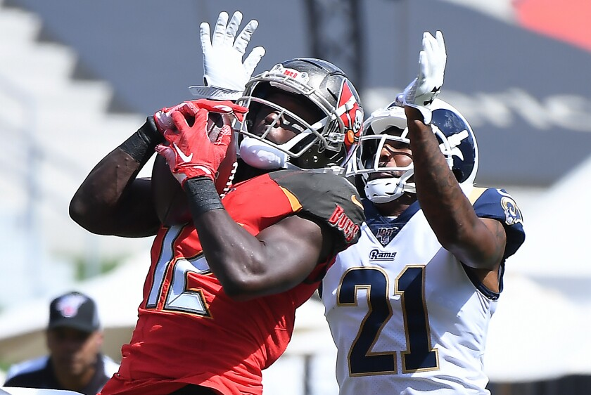 Buccaneers receiver Chris Godwin hauls in a pass against Rams cornerback Talib Aqib during a game two weeks ago.
