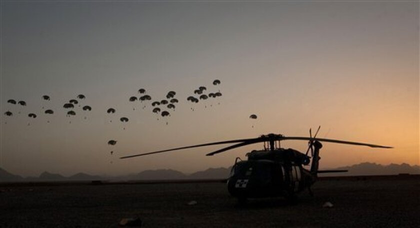 Food supplies for U.S. Marines hanging off small parachutes are dropped from a plane outside Forward Operating Base Edi in the Helmand Province of southern Afghanistan, Monday, June 6, 2011. (AP Photo/Anja Niedringhaus)