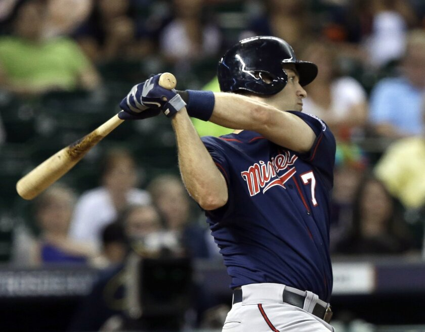 Minnesota Twins' Joe Mauer hits a two-run single to win the baseball game against the Minnesota Twins in the ninth inning Monday, Aug. 11, 2014, in Houston. The Twins won 4-2. (AP Photo/Pat Sullivan)