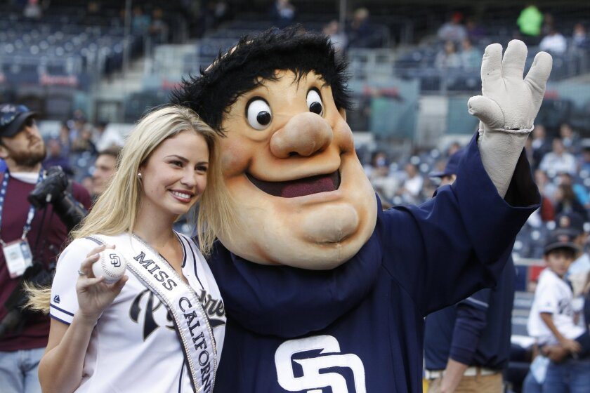 Miss California 2014 and San Diego local Cassandra Kunze poses with the Padres' mascot, the Swingin' Friar, before the start of the Padres game against the Minnesota Twins.