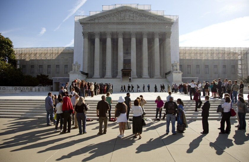 The Obama administration and civil rights groups are defending a key provision of the landmark Voting Rights Act at the Supreme Court Wednesday.