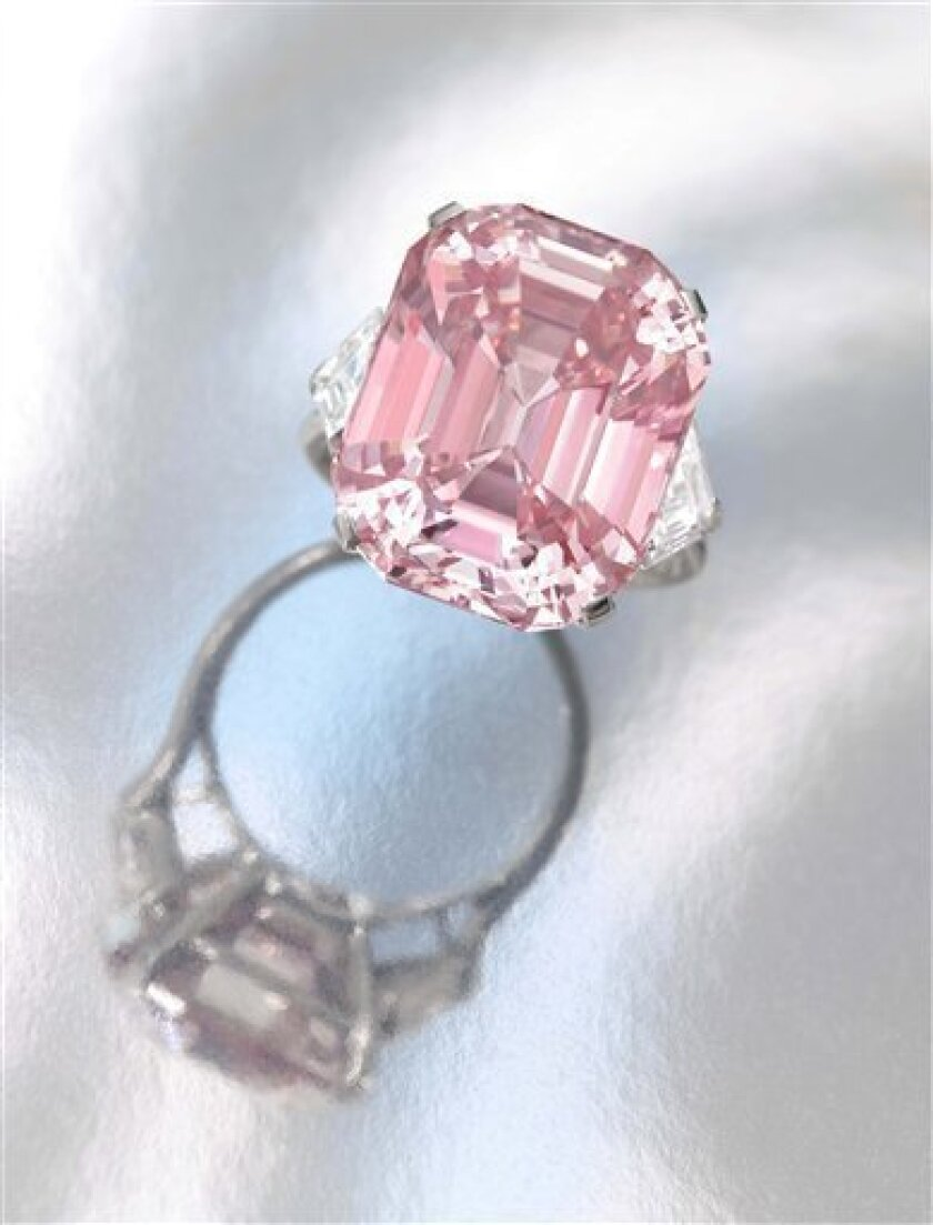"""This is an undated image of a pink diamond made available by Sotheby's Tuesday Oct. 5, 2010. Sotheby's says it will auction a rare pink diamond next month that could fetch up to $38 million. The auction house says the """"fancy intense pink"""" gem is being sold by an unnamed private collector and was last on the market 60 years ago. (AP Photo/Sotheby's)"""