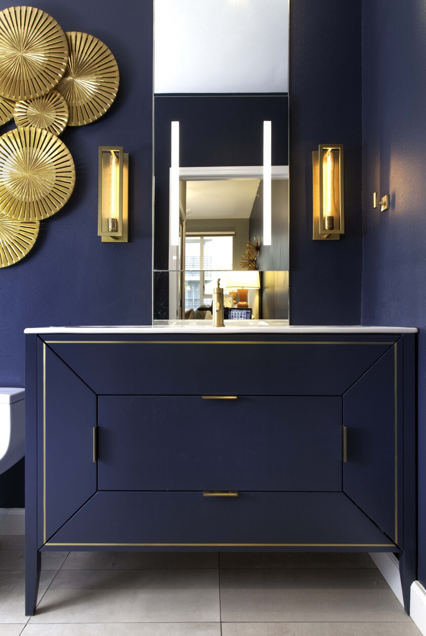 Because they aren't used every day, powder rooms offer a chance to get dramatic. One option is using bold colors.