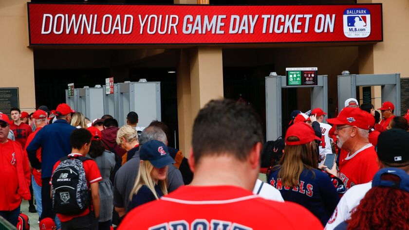 ANAHEIM, CALIF. - APRIL 04: A sign telling game attendees to download their game day ticket is displ