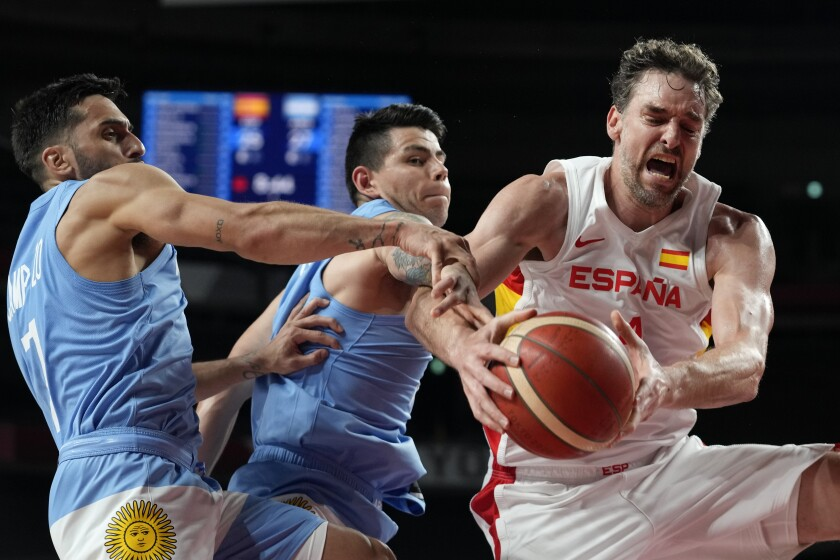 Spain's Pau Gasol, right, fights for a rebound with Argentina's Facundo Campazzo, left, and Gabriel Deck