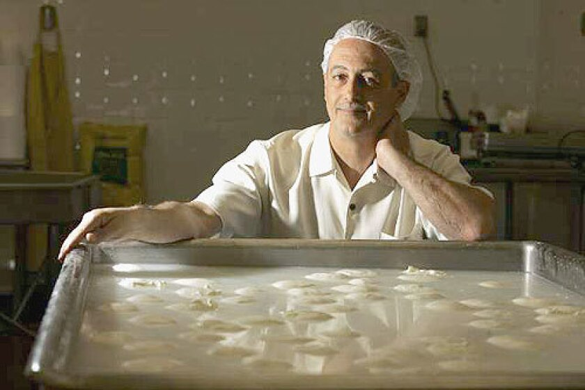 CHEESE MASTER: Vito Girardi with burrata at his Gioia Cheese Co. in South El Monte.