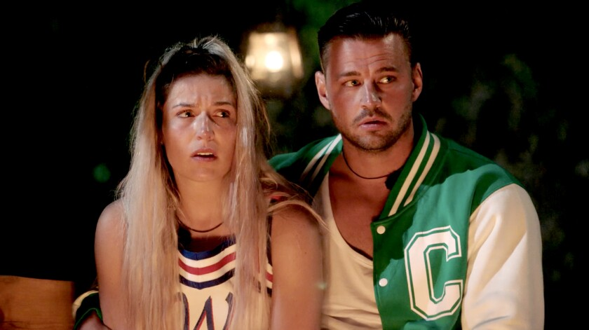 "Contestants Sian and Carl in ""Killer Camp"" on The CW."