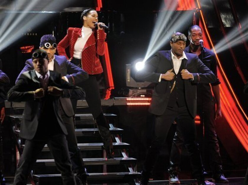 Alicia Keys performs at the Peopleís Choice Awards at the Nokia Theatre on Wednesday Jan. 9, 2013, in Los Angeles. (Photo by Chris Pizzello/Invision/AP)