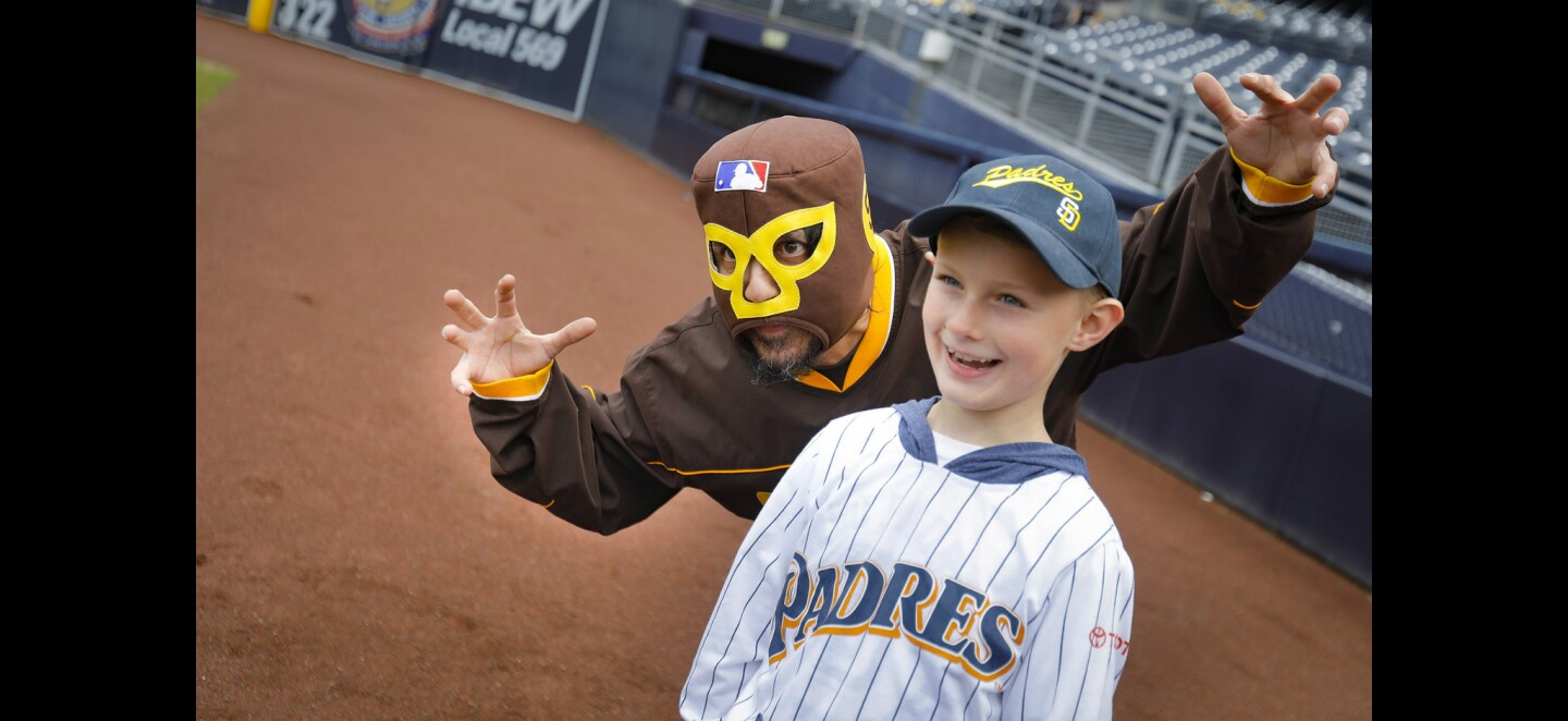 Mercury Hornbeek, left, of Linda Vista, poses for a photo with seven-year-old Cameron Morrison, right, of Santee, during Padres FanFest 2019, at Petco Park.