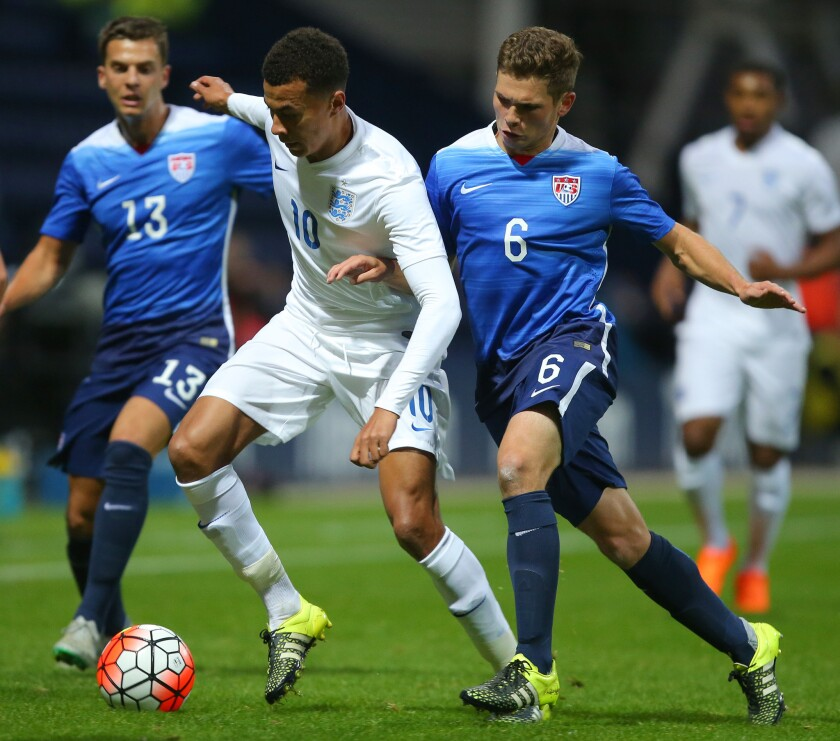 England's Dele Ali is challenged by Wil Trapp of USA during the International friendly match between England U21 and USA U23 on Sept. 3 in Preston, England.